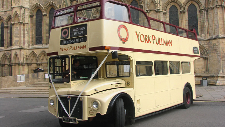 64 seat open top London Routemaster bus outside York Minster